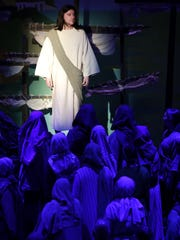 """Josh Verstegen, playing Jesus, stands among a group of followers during a scene in the """"Northeast Wisconsin Passion Play."""" The production continues through Sunday at the Xavier Fine Arts Theatre in Appleton."""