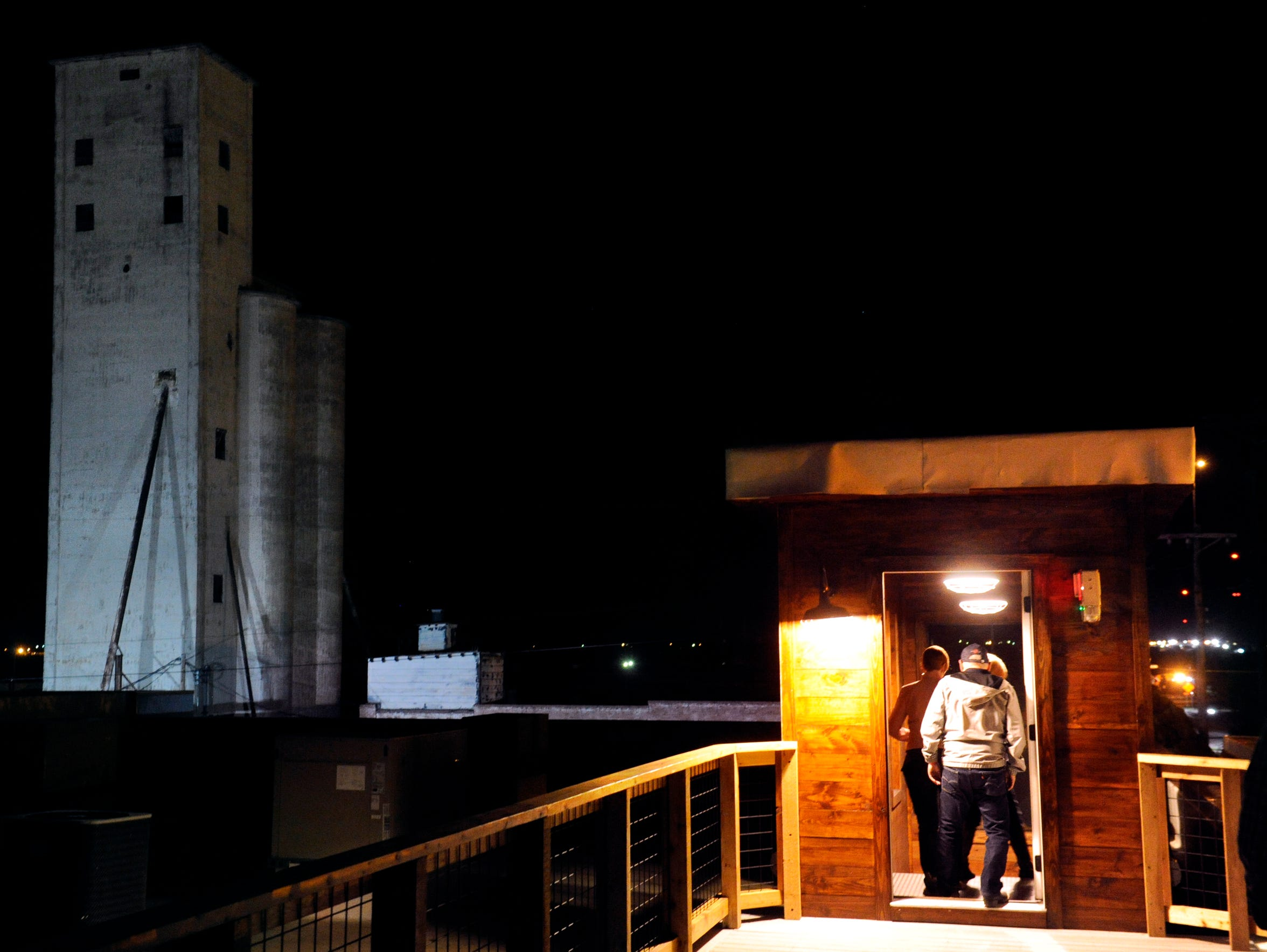 """Dancers return to the floor after taking in the view of downtown Abilene on top of Eller Hall Nov. 18. The new family-friendly, """"pop-up"""" dance hall is at 201 Mesquite St."""