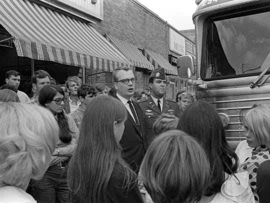 Members of the St. Cloud community say goodbye to the group of 55 enlistees who marched up St. Germain Street to board a bus to Minneapolis and begin their military service on Aug. 29, 1968.