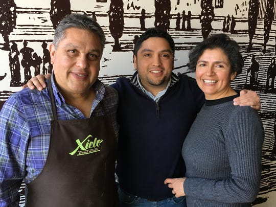 Juan Carlos Ramirez, center, and parents, Juan Carlos