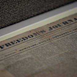 """A copy of """"Freedom's Journal,"""" the first African American newspaper, in a 2006 Black History Month exhibit at the National Press Club."""