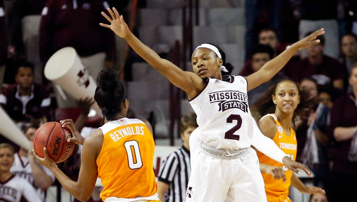 Mississippi State guard Morgan William (2) attempts to block a shot by Tennessee guard Jordan Reynolds (0)  in Starkville, Miss., Sunday, Feb. 26, 2017.