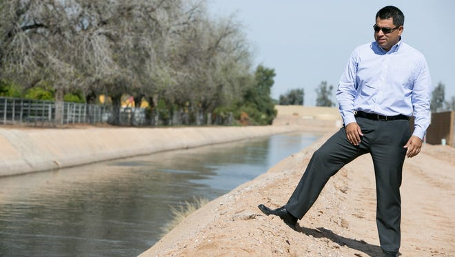 Tolleson City Manager Reyes Medrano Jr. wants to use canals to beautify his city and is willing to share liability with the Roosevelt Irrigation District to have a trail system.
