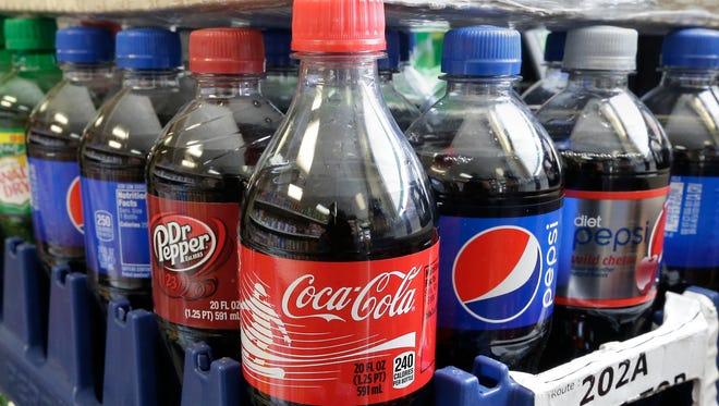 FILE - This Feb. 13, 2014 file photo shows sugary sodas in Sacramento, Calif.