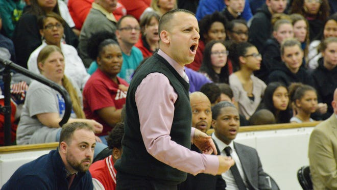 Shabaz Khaliq argues a call during a game on December 8, 2017 at South Side. Khaliq, a 2000 graduate of Earlham College, was officially hired as Richmond's new boys basketball coach Wednesday.