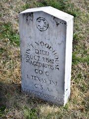 The Riverside Cemetery grave marker of John T. Woodhouse