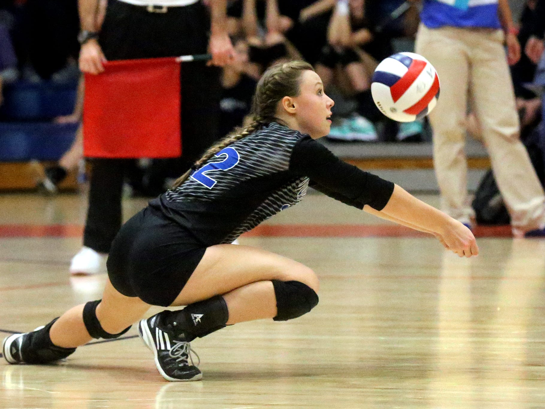Goodpasture's Tatum Fox dives for a dig during the first round of the TSSAA Class A state volleyball tournament against South Greene Wednesday at Blackman.