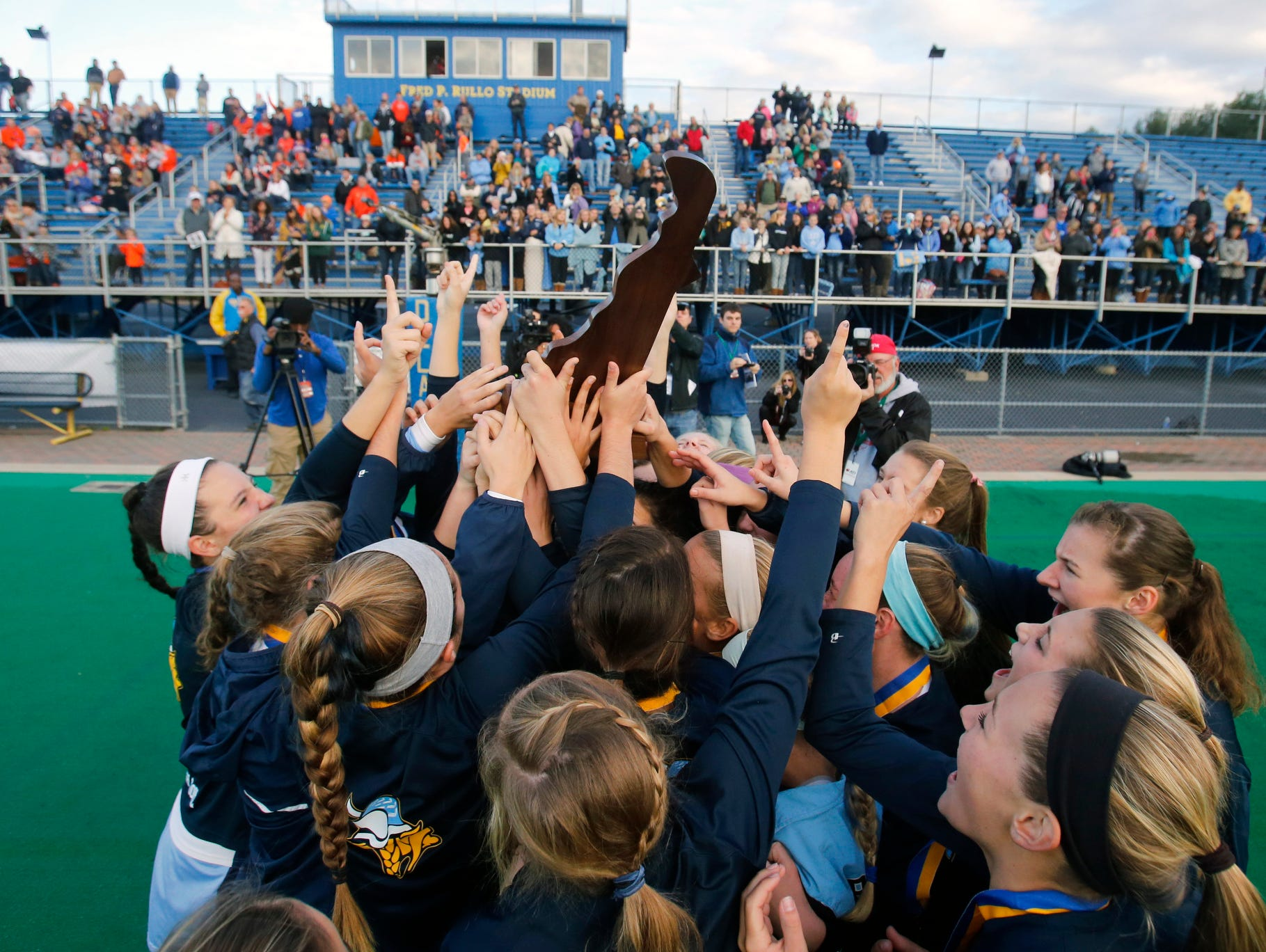 Cape Henlopen receives the DIAA state championship trophy after beating Delmar 3-1 Saturday at Rullo Stadium.
