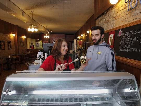 Deborah Owen of For Crepe Sake learns the art of serving gelato from Nick Lemmer of Iorio's Gelato of Ann Arbor.  For Crepe Sake has moved from the City Market to their new home on Washington Avenue, and will be serving Iorio's Gelato, along with their signature crepes and coffees.
