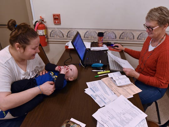 Tanya Johnson, left,  brought her son, Rhylen Miley, to have her taxes done Wednesday, Feb. 3, 2016 at Burt J. Aspers American Legion, Chambersburg. AARP tax Aide program agent Terry Murphy prepared taxes for the family.