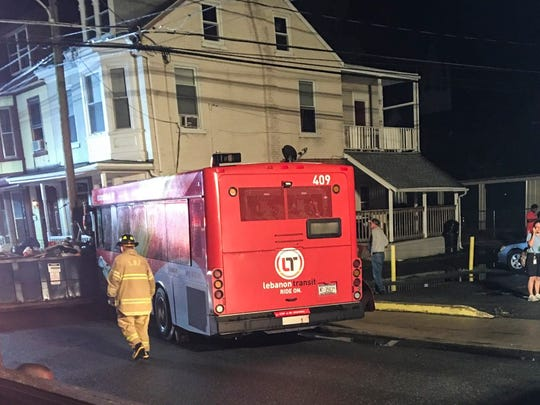 A photo of the out of control Lebanon Transit bus, damaged in a previous crash, carrying 23 passengers came stop at Church and Gannon streets after the driver intentionally stuck a dumpster to stop the bus.