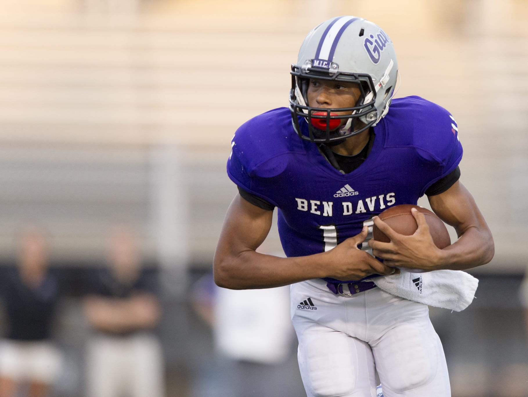 Ben Davis High School sophomore Reese Taylor (11) looks for a hole in the line as he rushes the ball up field during first-half action of a IHSAA varsity football game at Ben Davis High School, Friday, September 18, 2015.