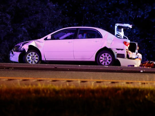 A car involved in an accident that left a pedestrian dead sits on I-95 southbound near Newark Friday. Delaware State Police said a person was struck and killed in the accident shortly before 8 p.m.