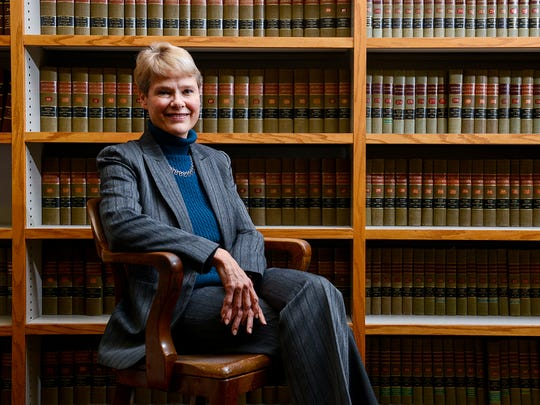 Carol Siemon has her portrait taken at the prosecutors office at the Veterans Memorial Courthouse Wednesday, Jan. 4, 2017 in Lansing.