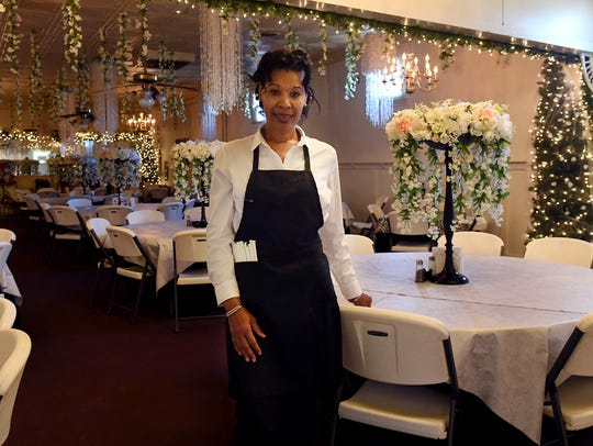 Cyd Reed stands inside of Royal Reed's restaurant,