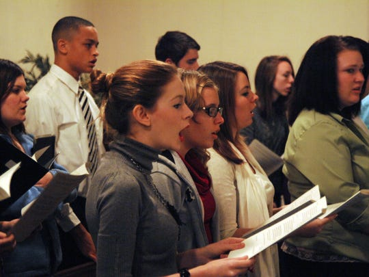 Members of the Henderson County High School Chamber Choir take part in singing a selection of traditional carols during the 78th Annual Alice P. Taylor Candlelight Service in this Gleaner file photo.