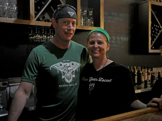 Tagan and Chris Counch stand behind the bar at Gypsy Uncorked's new location downtown at 801 Indiana Avenue. The pair held a sneak peek Saturday, March 17, 2018, during the St. Patrick's Day Street Festival.