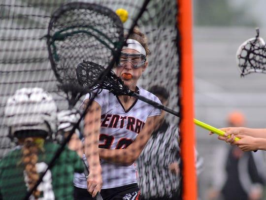 Central York's Liz Rader takes a shot on goal against