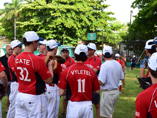 Grosse Pointe Avengers coach Brian Kruger speaks to his team before its first game on Aug. 3, 2017, in Havana, Cuba.