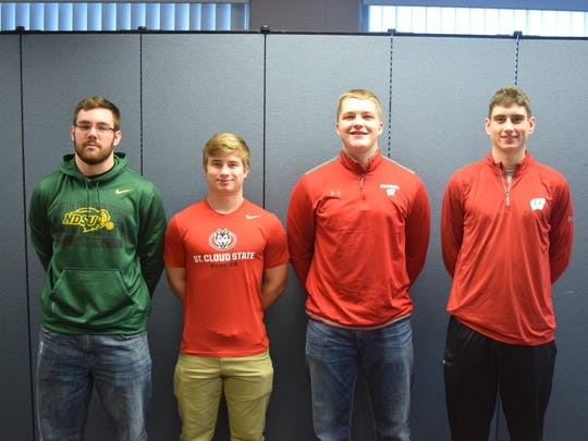 Kimberly football standouts, from left, Logan McCormick (North Dakota State), Adam Stage (St. Cloud State), Logan Bruss (Wisconsin) and Danny Vanden Boom (Wisconsin)