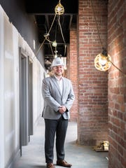 James Poole, the general manager of the Foundry Hotel on Market Street in Asheville, in one of the three historic buildings which were formerly part of the foundry which manufactured steel for the Biltmore Estate and other Asheville buildings. Encore Lodging is developing the 87-room hotel which will be managed by Charlestowne Hotels.