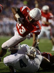 Beechwood's James Davis dives into the end zone over Simon Kenton's Will Parks to give the Tigers a 6-0 lead during their game at Beechwood, Friday, September 29, 2017.