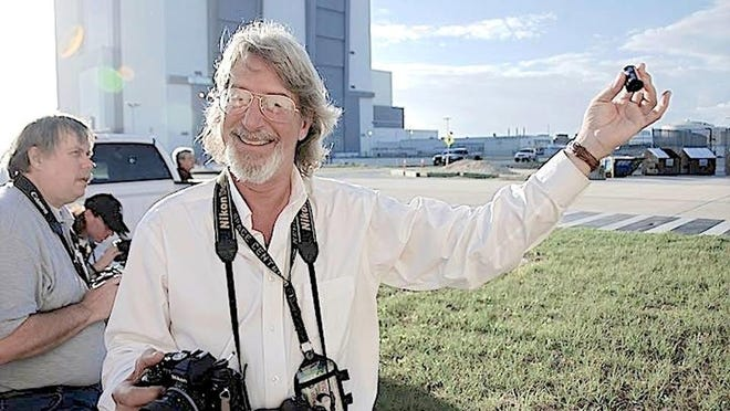 Lloyd Behrendt holds up a roll of Tri-X film on the day of the launch of Space Shuttle Atlantis, mission STS-132, which would be the fourth-to-last shuttle mission.