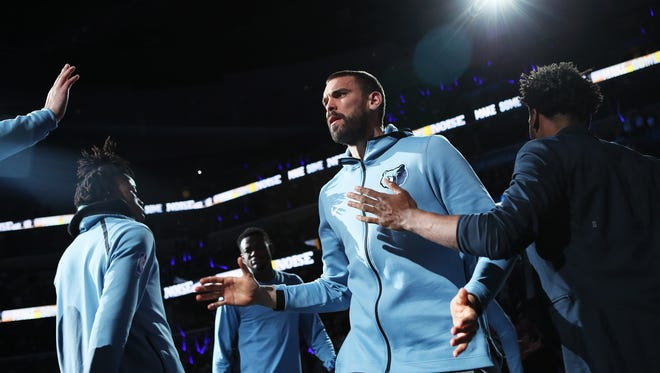 December 15, 2017 - Memphis Grizzlies center Marc Gasol (33) high fives his teammates as he enters the court to compete against the Atlanta Hawks at FedExForum on Friday.
