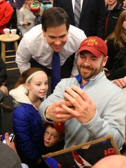 Republican presidential candidate Marco Rubio pauses