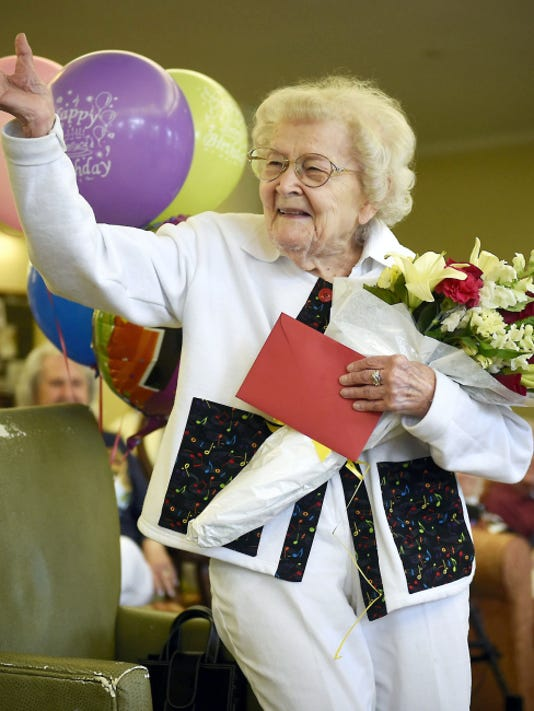 Nancy Hatz waves after being recognized at a birthday celebration June 26 at Traditions of Hershey in South Londonderry Township.