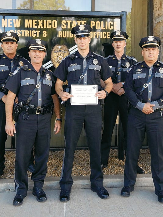 New Mexico State Police Officer of the Quarter, Patrolman Chance Hooper (front center), receives award. From right, Senior Patrolman Samuel E. Huston, Captain Stephen P. Cary, Hooper, Sgt. Duane Bullion and Lt. Leonardo Ornelas.