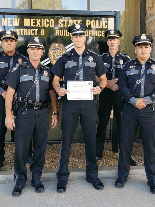 New Mexico State Police Officer of the Quarter, Patrolman Chance Hooper (front center), receives award. From right, Senior Patrolman Samuel E. Huston, Captain Stephen P. Cary, Hooper, Sgt. Duane Bullion and Lt. Leonardo Ornelas.