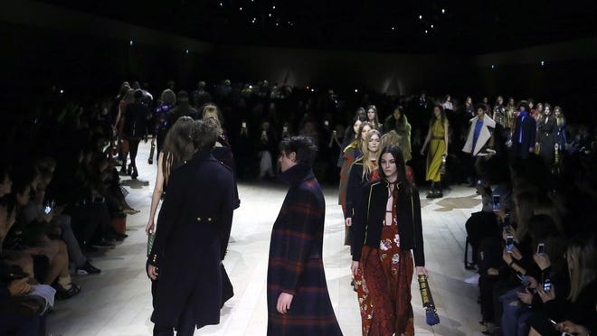 Models display designs during the Burberry Autumn/Winter show at London Fashion Week, Monday, Feb. 22, 2016. (AP Photo/