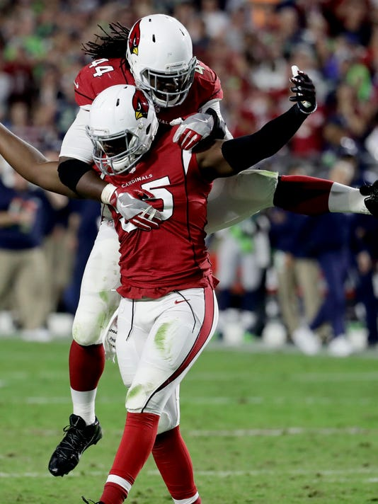 Arizona Cardinals outside linebacker Chandler Jones (55) celebrates his defensive stop with teammate Markus Golden (44) during the second half of a football game against the Seattle Seahawks, Sunday, Oct. 23, 2016, in Glendale, Ariz. (AP Photo/Rick Scuteri)