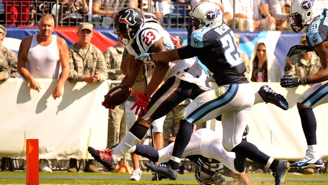 NASHVILLE, TN - OCTOBER 26:  Running back Arian Foster #23 of the Houston Texans scores a touchdown against the Tennessee Titans at LP Field on October 26, 2014 in Nashville, Tennessee.  (Photo by Frederick Breedon/Getty Images)