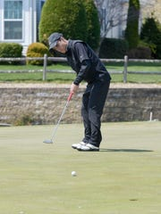 Matt Rizzo of Southern putts on 14. The Ocean County High School Golf Tournament was played at the Westlake Country Club in Jackson, NJ, on Monday, April 11, 2016.
