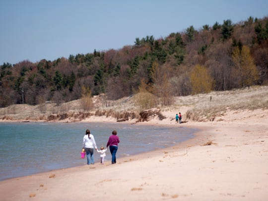From left to right, Hannah Deurloo, her daughter Brandy, 19 months, Dorothy Rought hold hands while walking along Lake Michigan on Thursday, May 19, 2016 at Mears State Park in Pentwater, Mich. Rought, Brandy's great grandmother, has lived in Pentwater for over 50 years.