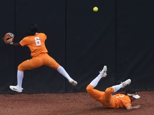 At left Tennessee's CJ McClain (6) and Tennessee's Jenna Holcomb (2) miss a fly ball in the outfield during an NCAA Super Regional game between Tennessee and Texas A&M at Sherri Parker Lee Stadium on Saturday, May 27, 2017. Texas A&M defeated Tennessee 6-5.