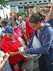 Tamika Catchings (right) stopped to give an autograph