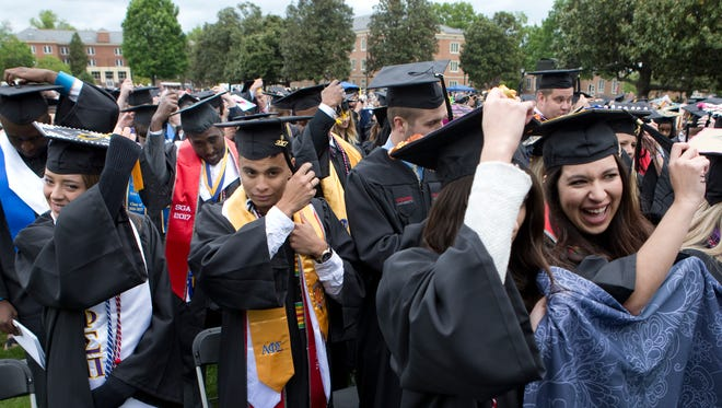 Graduates turn their tassels during the conferring of degrees portion of the commencement ceremony at Radford University May 6, 2017.