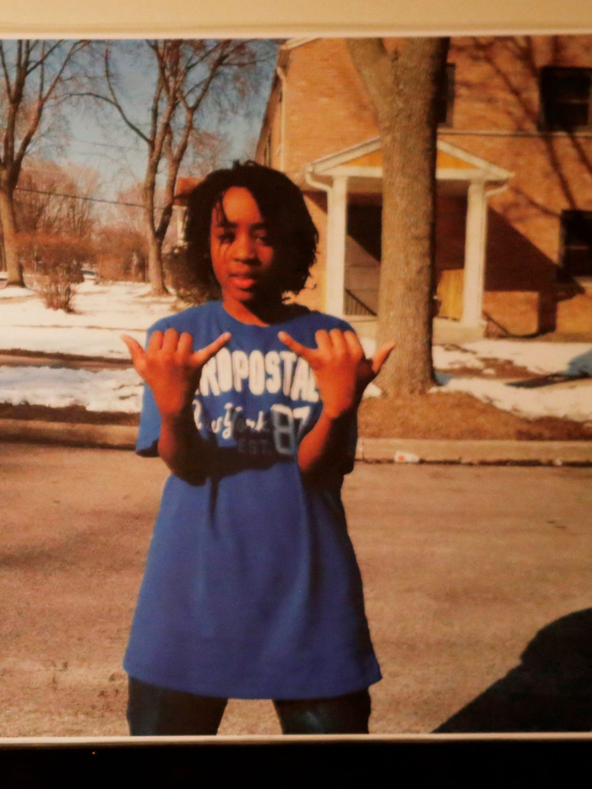 A poster photo shows Giovonnie Cameron, 13, who was