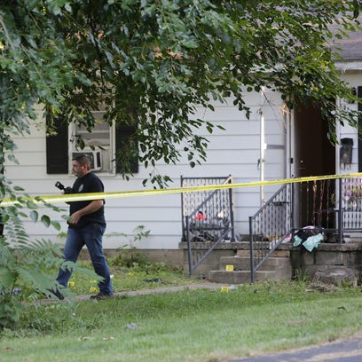 Lafayette police detectives investigate a shooting,
