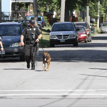 Marion Police officers search the east-side neighborhood
