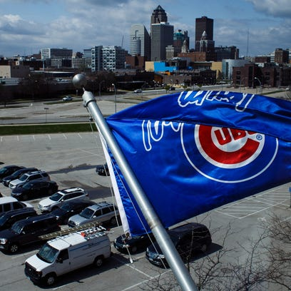An Iowa Cubs flag flies over the parking lot during