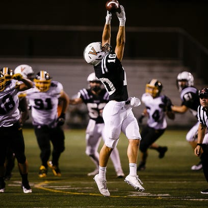 Valley's Beau Lombardi hauls in a pass against Bettendorf
