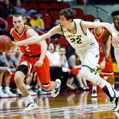 Iowa City West's Patrick McCaffery (22) steals the