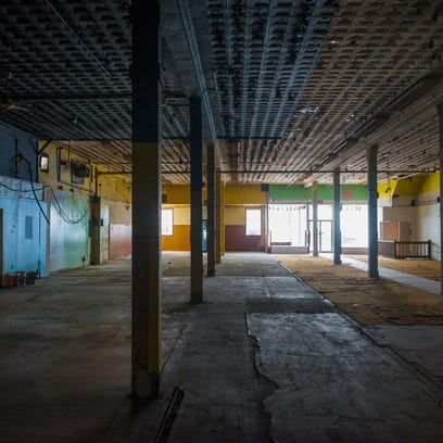 The street level floor with 15-foot ceilings is seen