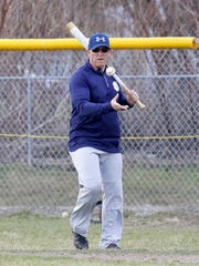 Notre Dame head coach John Knapp hits to his team for batting practice before a scrimmage against Elmira on March 24.