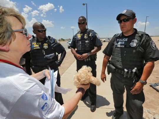 Randi Weingarten tries to deliver a teddy bear and other items for children to federal agents at the port-of-entry, Tuesday, June 26, 2018, in Fabens, Texas, along the international border where immigrant children are being held. The group tried to deliver items to the children housed in tents at the facility but were turned away.