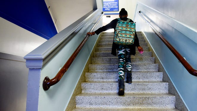 A student walks up one of the many sets of stairs at the 94-year-old Whittier Middle School which has no room for additions and features small classrooms. With the school district releasing a new master facilities plan later this year the building's future is uncertain.